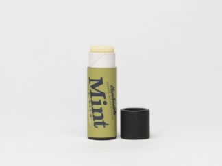 Mint lip balm on white background