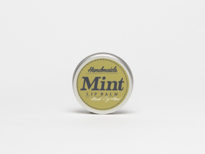 Mint lip balm in jar on white background