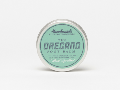 Oregano foot balm on white background
